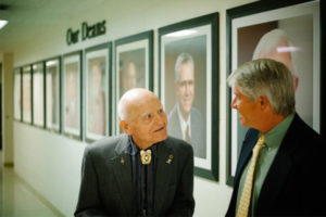 two deans in a hallway