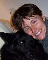 smiling woman with black dog