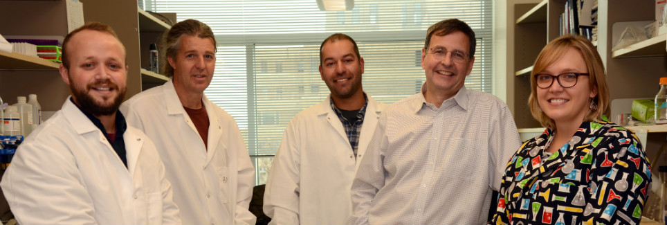 Davis Witt in the lab with his colleagues at CU Anschutz