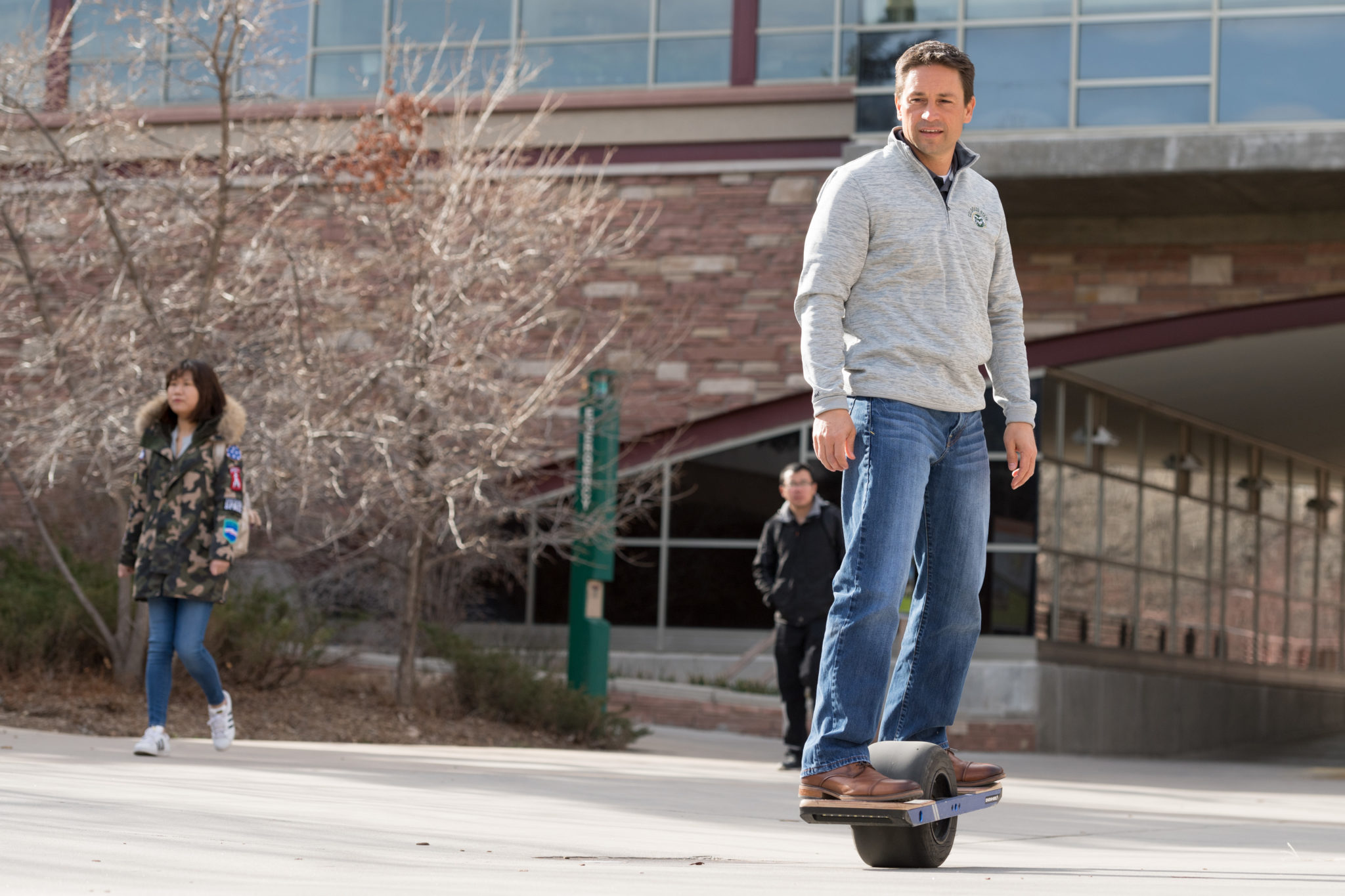 Biomedical Sciences Assistant Professor Tod Clapp riding his Onewheel on campus.