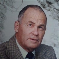 Dr. Robert Pierson, plaid coat, dark tie