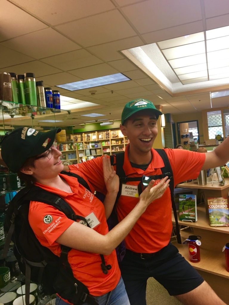 Katie Brown striking silly poses with fellow counselor Andrew Degenhart at the CSU Bookstore