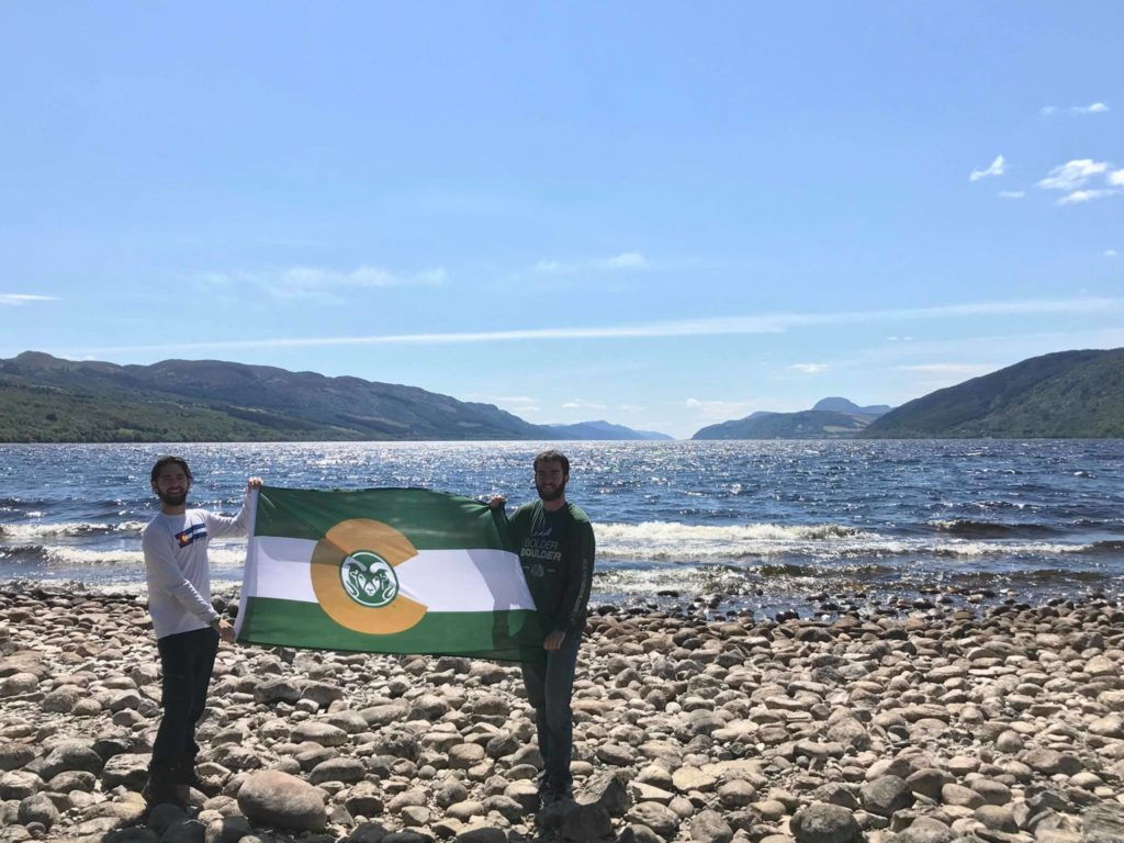 Dillon and another CSU student holding a CSU flag at Loch Ness in Scotland.