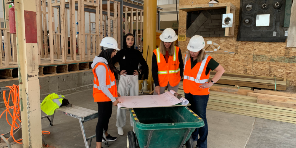 Slam poet Merall Sherif and instructor Anna Fontana filming in a construction management lab for the Women in Science video.