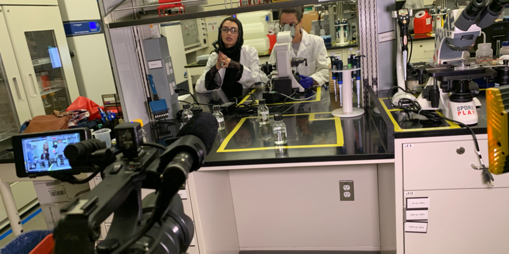 Slam poet Merall Sherif and Jenna Gallegos filming in an engineering lab for the Women in Science video.