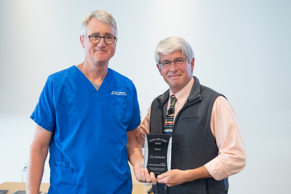 Dean Mark Stetter (right) presents Nic Lambrechts (left) with the Respect Award.