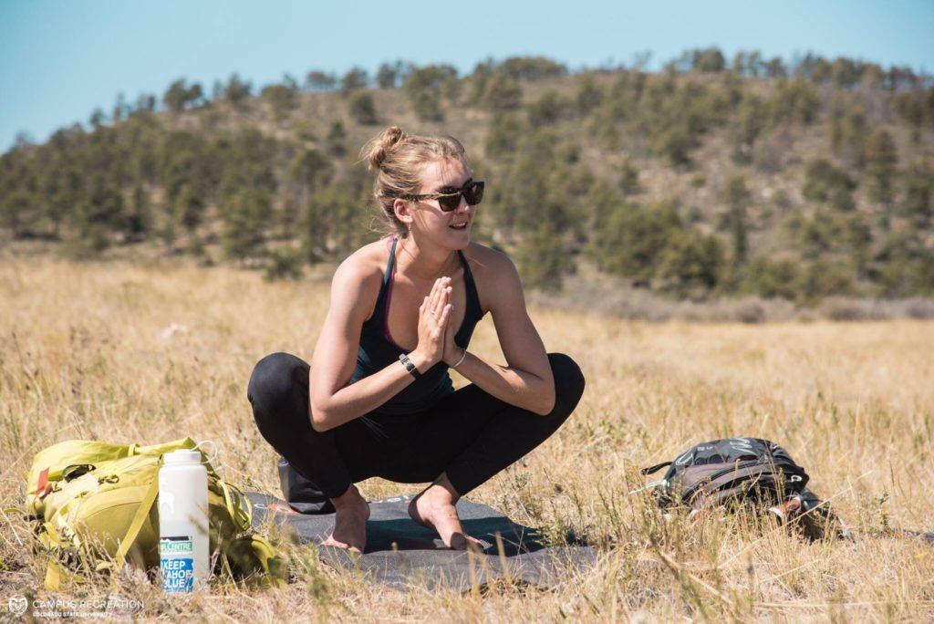 Sara Hanneman doing yoga outside