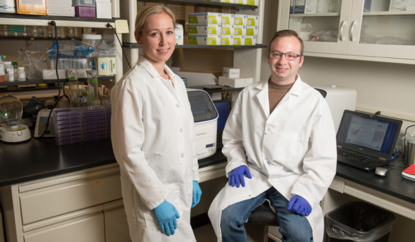researchers Rebekah Kading and Nick Bergren in Kading's Lab at Colorado State University