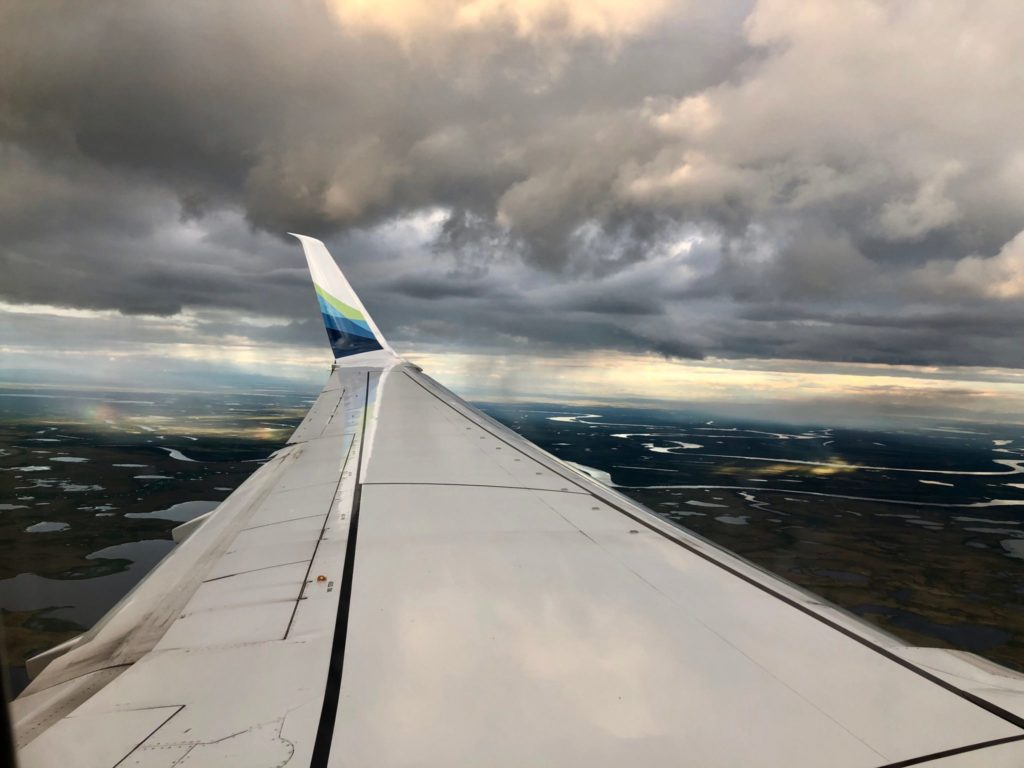 airplane wing over Alaska