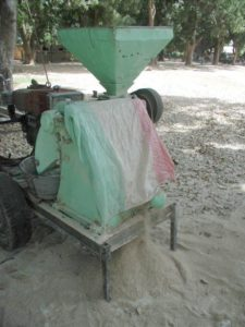 rice is milled in a machine in Mali