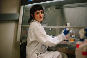 Scientist Anna Fagre poses for a photo while working in the lab
