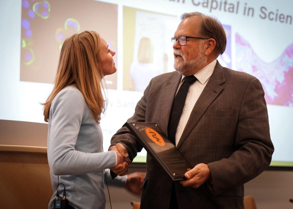 Kelly Santangelo receiving a plaque from Harvey Krumm of Zoetis