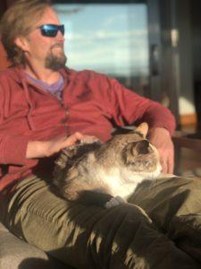 cat rests on man's lap