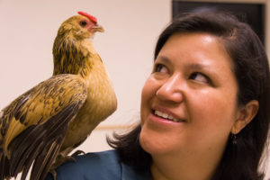 Kristy with a chicken on her shoulder