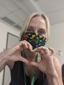 Bekah McMinn, MIP Ebel Lab, makes a heart symbol with her fingers.