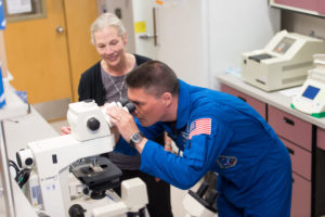 Susan Bailey and Kjell Lindgren in Bailey's lab