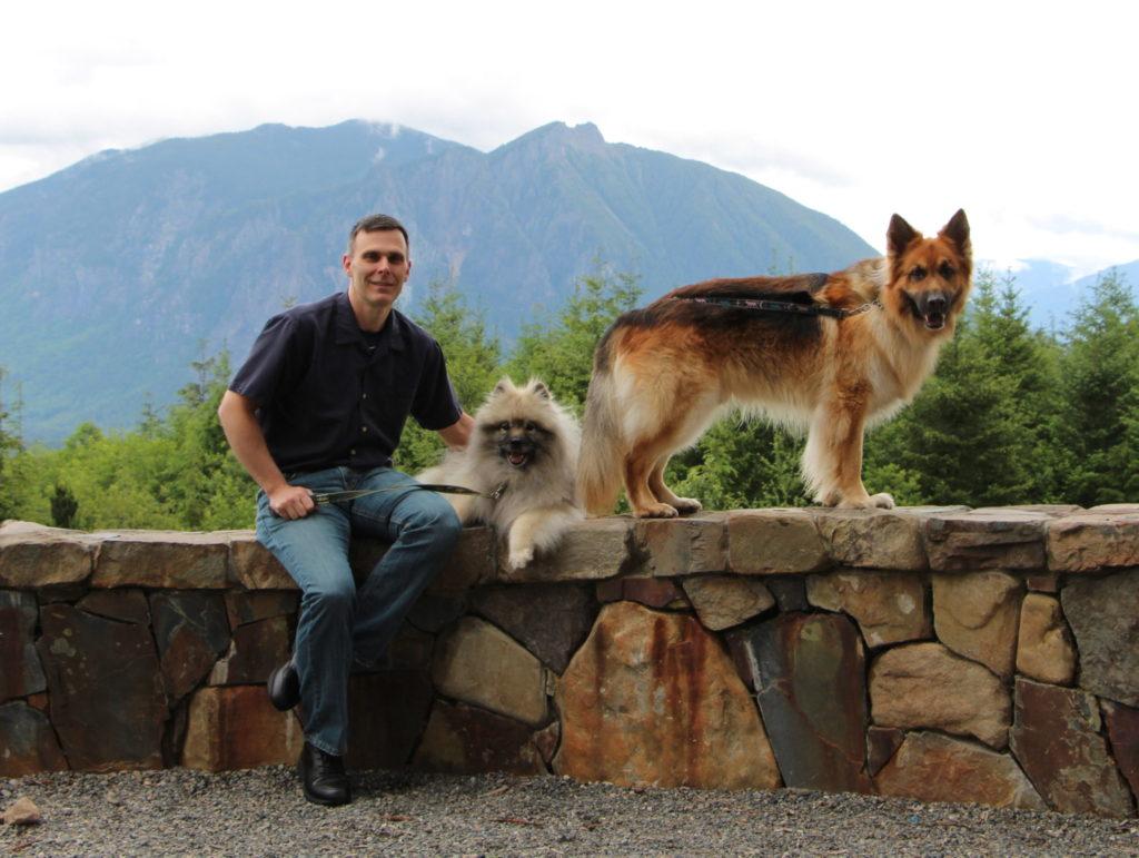 Matt Kaeberlein with two dogs